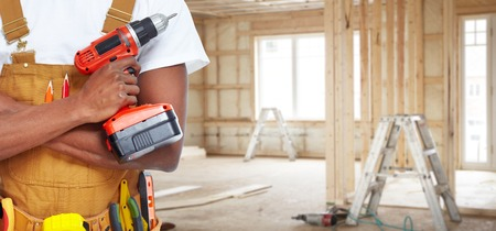 Builder handyman with construction tools. Stok Fotoğraf - 37863563