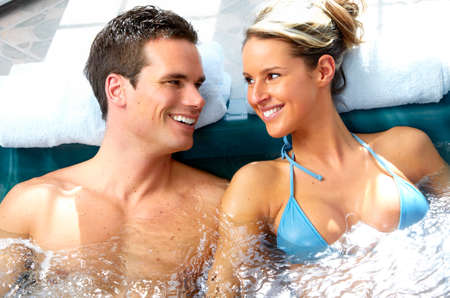 Young couple relaxing in a pool