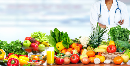 Doctor woman with vegetables. Healthy diet and nutrition. Stock Photo