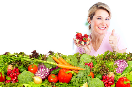 Senior woman with fresh vegetables and fruits. Healthy diet.