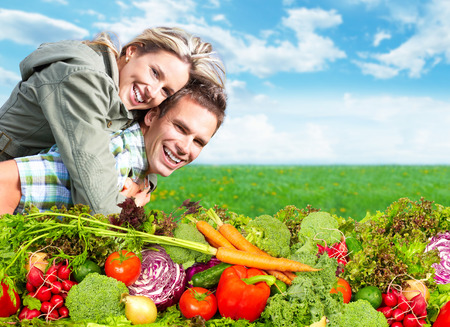 Happy couple with fresh vegetables and fruits. Healthy diet. Stock Photo
