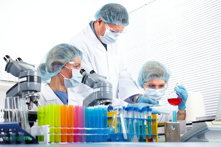 Group of medical doctors in laboratory. Scientific research. Stock Photo