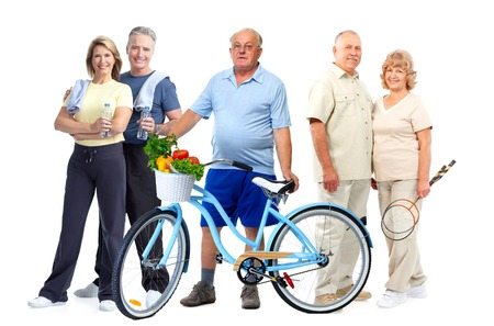 Group of elderly fitness people with bicycle isolated white background. Stock Photo
