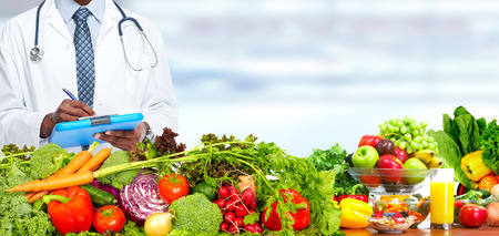 Doctor man with vegetables. Healthy diet and nutrition. Stock Photo