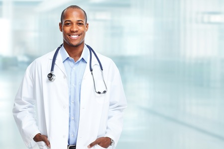 Medical physician doctor man over hospital background.
