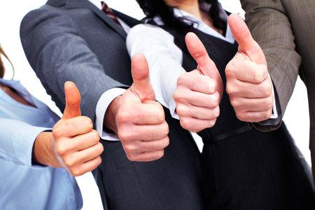 Handen van gelukkige mensen uit het bedrijfsleven met duimen. Stockfoto