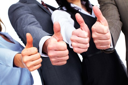 Hands of happy business people with thumbs. Stock Photo