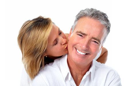 Happy kissing elderly couple isolated white background.