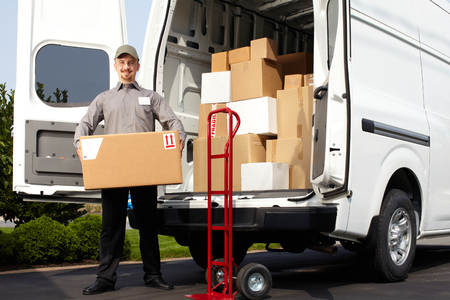 Young delivery man with parcel near cargo truck. Shipping service. Banco de Imagens - 45282892