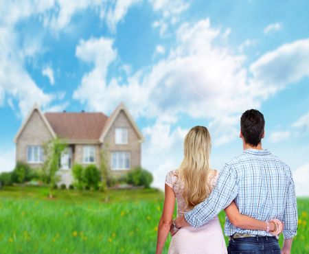 Young loving couple looking at new home. Mortgage.