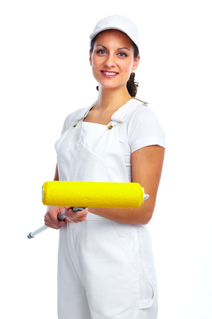 Beautiful woman with painting roller. House renovation. Фото со стока