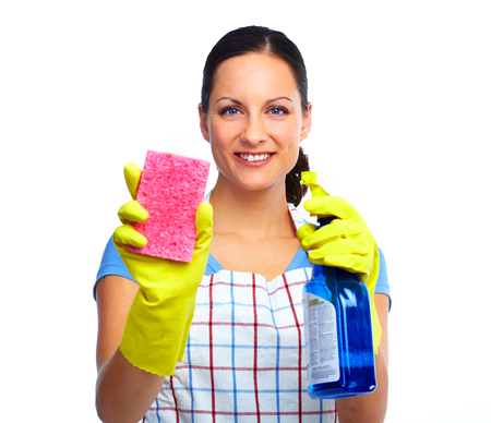 Maid woman with sponge and spray. House cleaning service concept. Imagens
