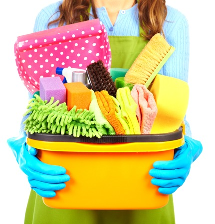 Maid hands with cleaning tools. House cleaning service concept. Imagens