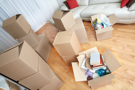 Moving boxes in new apartment. Real estate concept. 스톡 콘텐츠