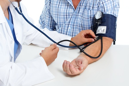 Doctor checking old man patient arterial blood pressure. Health care. Banque d'images