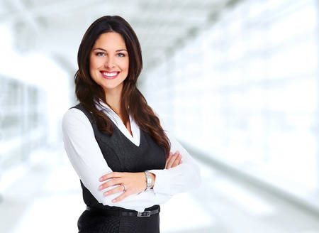 Portrait of happy young business woman over office background Banco de Imagens - 45594065