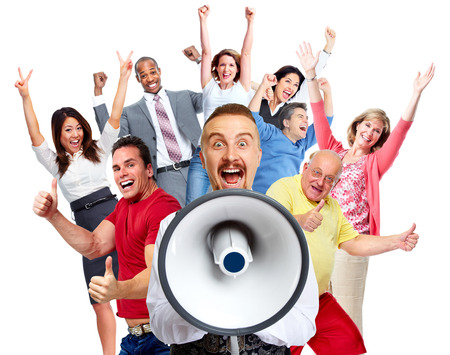 Young man talking in loud-hailer and group of happy people. Stock Photo