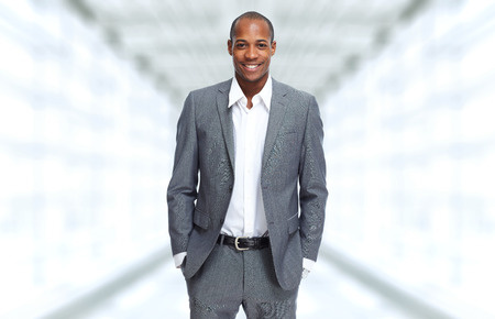 African-American Businessman over office background 스톡 콘텐츠