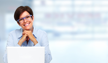 Beautiful business lady with laptop computer in office. 写真素材
