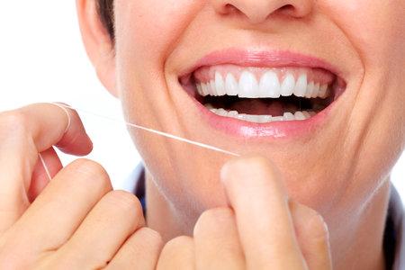 Beautiful woman white teeth. Dental health care. 版權商用圖片