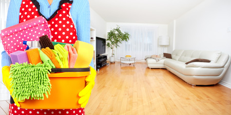 Maid hands with cleaning tools. House cleaning service concept. Stok Fotoğraf