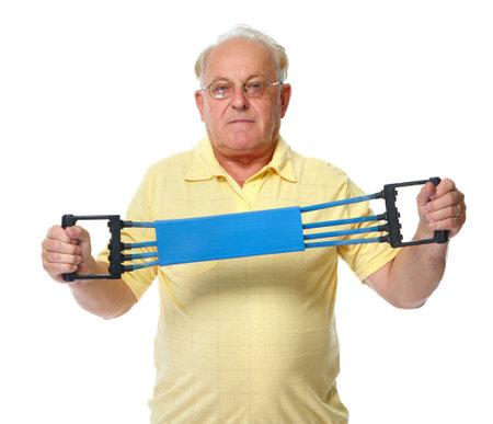 Elderly man with chest expander. Isolated white background. 版權商用圖片