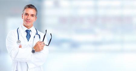 Friendly Family doctor man over hospital banner background.