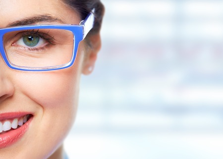Beautiful Woman eye with glasses over blue banner background.