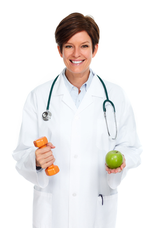 Mature medical doctor woman isolated over white background. Archivio Fotografico