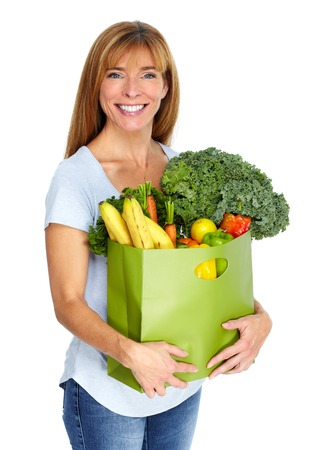 Woman with grocery bag of vegetables isilated white background. Stok Fotoğraf