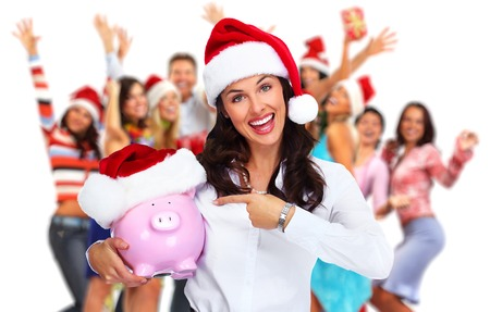 Santa Christmas business woman with a piggy bank over people group background. 版權商用圖片