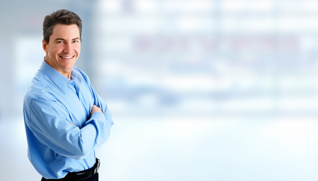 Handsome businessman portrait over blue banner background. Imagens