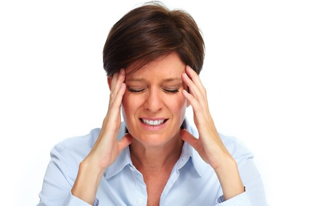 Tired business woman with headache migraine over white Stock Photo