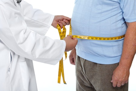 Doctor measuring obese man waist body fat. Obesity and weight loss. Фото со стока - 46630142