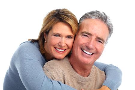Happy smiling elderly couple isolated white background. Standard-Bild