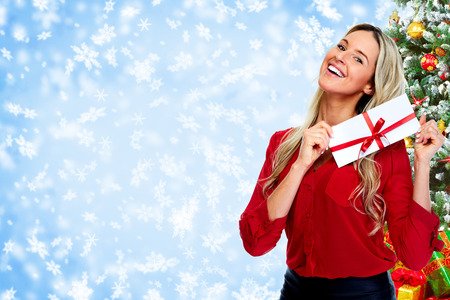 Happy  woman with envelope over Christmas background.