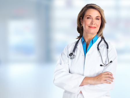 Elderly clinic doctor woman over hospital background.