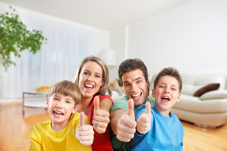 Happy family in a new house. Real estate and moving background.