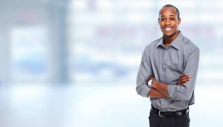 African-American Businessman over blue office background Stock Photo