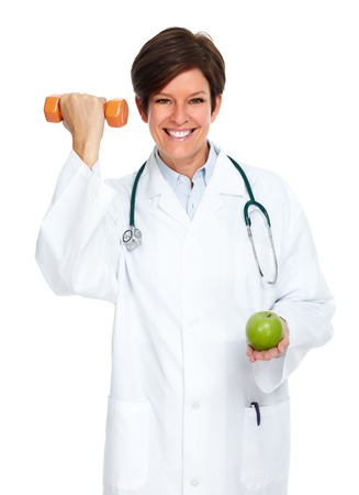Mature medical doctor woman isolated over white background. Stock fotó