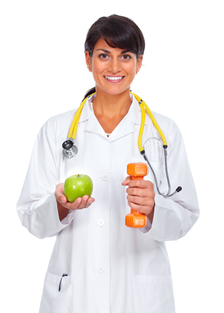 Young medical doctor woman isolated over white background.