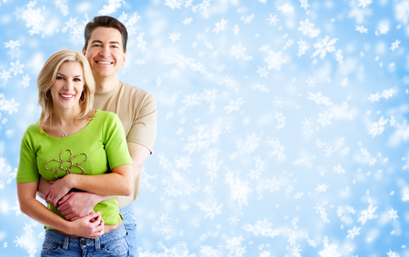 Happy loving couple over snowy banner background. Stock Photo