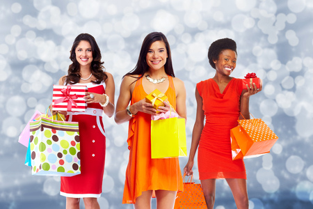 Group of Woman with shopping bags over Christmas background. Stock fotó