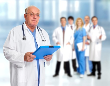 Elderly clinic doctor man over people group background. Imagens