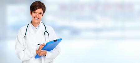 Smiling Doctor woman over clinic banner background.