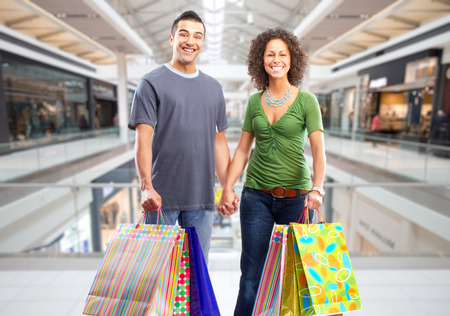 Shopping couple with paper bags in a shopping mall . Stock fotó