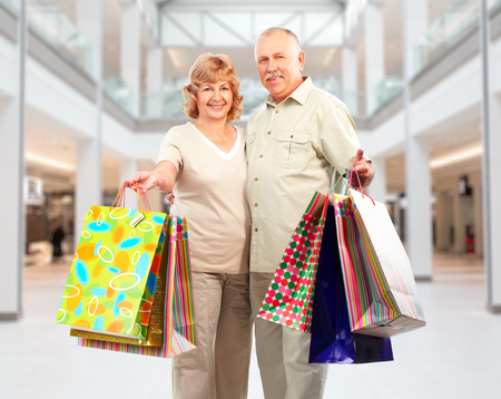 Shopping couple with paper bags in a shopping mall . 스톡 콘텐츠