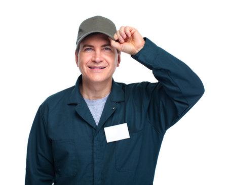 Glimlachende knappe loodgieter man. Geïsoleerde witte achtergrond. Stockfoto