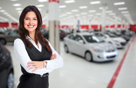 Car dealer woman. Auto dealership and rental concept background.