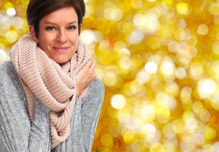 Mature woman with scarf. Winter and Xmas background.